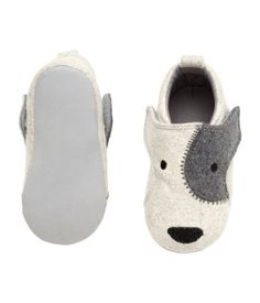 Felt slippers with appliqués and embroidery. Velcro fastener at side, cotton lining, and soft soles.