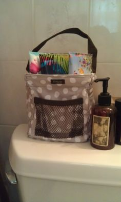 lotsa dots littles carry-all caddy on the back of toilet holding body lotions. Thirty One Organization, Bathroom Organization, Organization Ideas, Thirty One Party, Thirty One Gifts, Thirty One Uses, Thirty One Business, Thirty One Consultant, Zero One