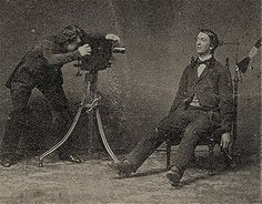A post-mortem photographer at work. 19th century.