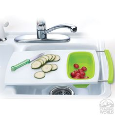 Over-the-Sink Cutting Board - Saves counter space & features a small collapsible colander for rinsing produce after chopping.