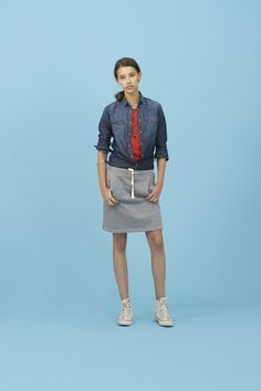 The perfect casual and sporty look comes from American college uniforms: a midi fleece skirt paired with a red top and classic dark denim shirt #SUN68 #SS16 #woman #shirt #college #skirt #denim