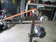Homemade belt grinder constructed from square steel tubing. Powered by a 2 HP motor.Belt Grinders
