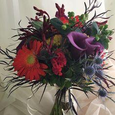#fallwedding colors make us giddy #callalilly #gerberdaisy #thistle #agonis @zen_anelegantspaceforhire #yeahthatgreenville #rbdbride