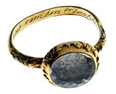 "A woman's memorial poesy ring from 1592, made of gold and rock crystal -- ring's inner surface is inscribed, ""The cruel seas, remember, took him in November."""