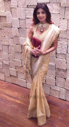 Yoga beauty Shilpa Shetty in gold shimmer saree, designed by Preeti kapoor, posted on her Instagram profile. Amarapali jewelry and free hairstyle finished