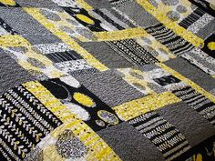 black, gray and yellow quilt
