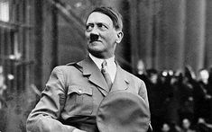 This is a picture of Hitler. He seems to be being praised by his followers in the background of the picture. He looks as if he is pretty happy.