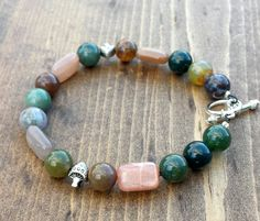 Indian Agate, Peach Moonstone, and a couple little Mushrooms by NidraBeads on Etsy Indian Agate, Peach Moonstone, Spiritual Jewelry, Healing Stones, Stuffed Mushrooms, Jewelry Making, Beaded Bracelets, Couple