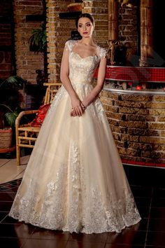 This enchanting wedding gown will make you a gorgeous bride.  This close-fitting cut will accentuate the winsomeness and femininity of your figure. The sateen corset embellished with lace décor, which stretches onto the tulle skirt deserves a special mention, making the look romantic and fragile, while the lace straps bring refinement and, in combination with the transparent mesh on the back, they add a tone of mystery to your appearance.  Be the enchantress of your wedding in thi...