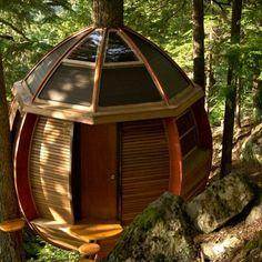 THE HEMLOFT WHISTLER, BRITISH COLUMBIA  A hidden gem amid towering hemlock trees in the ski village of Whistler, British Columbia, this ovoid tree house is a sight to be seen—for those who can find it, that is. Carpenter Joel Allen built the structure in a secret location and welcomes anyone who spots it to check out the inside, which contains oak furnishings, a covered deck with a camp-style kitchen, a desk area, and a sleeping loft.