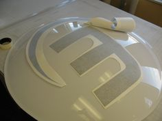 Here's a sneak peek of applying vinyl to the illuminated lobby sign we created for Magnet 360.