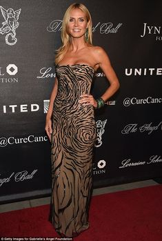Belle of the ball: Heidi Klum dazzled at the Angel Ball 2015 in New York on Monday