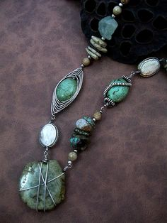I love this necklace, which uses lots of different jewelry techniques.  It is really different!