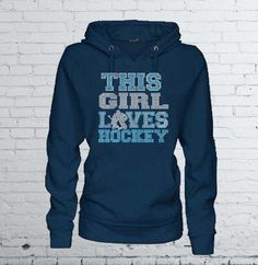 """""""This Girl Loves Hockey"""" Women's Hoodie Sweatshirt by MadJoApparel. Embellished with premium rhinestone bling. Makes a great gift for a hockey mom or fan!"""