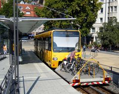 This innovative solution from Stuttgart, Germanyadds desperately needed bicycleaccommodation on this light rail line.