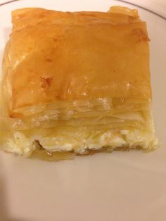Cheese Boreg: Mix together: 10-oz feta 1C shredded cheese 4-oz cream cheese 2 egg Melt: 1 1/4 stick butter Add and  then coat phyllo in pyrex: 1/2C milk 2 eggs 2T oil Half way add cheese mix, continue with phyllo. Brush: 1 egg yolk Cut into squares, Add bal of butter. Bake 350º 40 - 55 min