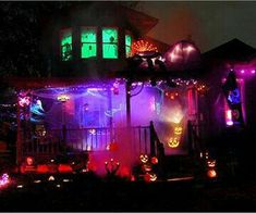 A very well done Home Haunt. I love the various colored lights, fog & Pumpkins.