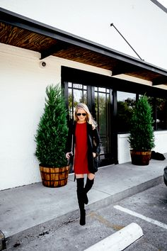 red holiday dress and over the knee boots