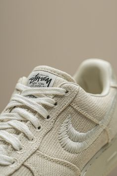 """Last year, Stussy celebrated its 40th anniversary by collaborating with Nike on a pair of Air Force 1s in a rugged canvas material. The """"Fossil"""" was the more limited colorway of the two, as it was released exclusively in Stussy Chapter stores and online. Air Force Ones, Nike Air Force, Pharrell Williams, Jordan 4, 40th Anniversary, Stussy, Canvas Material, Shoe Game, Fossil"""