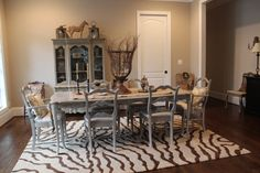 This is a beautiful French Country Dining Set. The Table is almost 7ft and can be shorted by taking out the 2 leaves. There are 6 chairs total (2 arm chairs for the heads of the table). All antiqued & distressed in a Paris Grey color. The seats of the chairs have been covered in a soft white burlap.