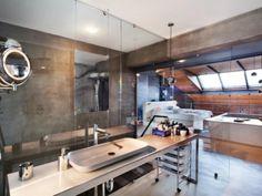 Ofist imagine un loft combinant le métal et le bois