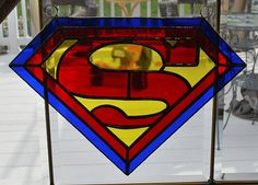 This stained glass superman shield suncatcher, wall hanging is finished in a Tiffany style copper foil technique and is approx. 9 H X 11 W Making Stained Glass, Faux Stained Glass, Stained Glass Projects, Stained Glass Windows, Superman Art, Superman Symbol, Batman, Glass Painting Designs, Colored Glass