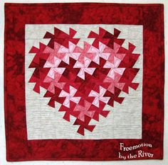 Twisting Heart Valentine at Freemotion by the River I used 3 1/2 inch squares in the following colors: 10 dark red squares    11 red squares 6 medium pink      7 light medium pink 15 background squares     Use a 1/4th inch seam allowance.