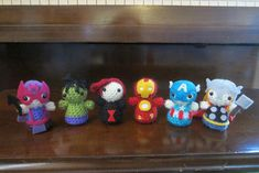 Mini amigurumi super heroes!  Link to free crochet pattern and pics of many other heroes, check it out!