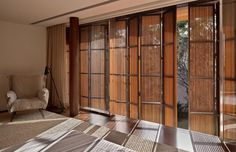 "I like the bamboo ""curtains"" on the glass doors. House Design, Home, Shutter Doors, Interior Shutters, Windows And Doors, House Styles, Interior Window Shutters, Farmhouse Style House, Window Treatments"