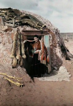 Navaho Girl in front of her Hogan