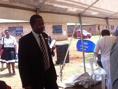 Joshua Mabogoane, Principal of the host school: Besilindile Primary School entering the tent.