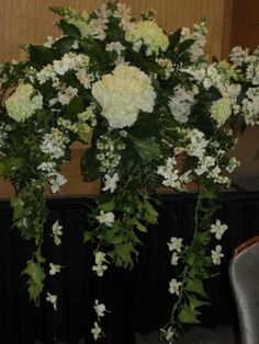 ALL WHITE ARRANGEMENT DESIGNED BY THE LITTLE SHOP OF FLOWERS IN STILLWATER, OK FOR INFORMATION CALL 405-372-1200
