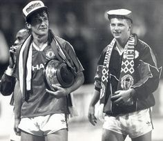 In black and white: Sir Alex Ferguson's first trophy with United came in the 1990 FA Cup final - here Mark Hughes and Mark Robins celebrate