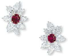 A PAIR OF RUBY AND DIAMOND EARRINGS, BY BULGARI  EACH SET WITH AN OVAL-SHAPED RUBY MEASURING APPROXIMATELY 2.49 AND 2.25 CARATS, WITHIN A PEAR-SHAPED DIAMOND FOLIATE SURROUND, MOUNTED IN PLATINUM AND 18K YELLOW GOLD, 3.0 CM LONG, IN BLACK LEATHER BULGARI CASE  SIGNED BULGARI