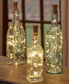 Give new life to your empty wine bottles with a Set of 3 Wine Bottle Stopper String Lights. These lights transform any bottle into a romantic mood light, w # diy wedding decorations Sets of 3 Wine Bottle Stopper String Lights Wine Bottle Stoppers, Wine Bottle Crafts, Wine Bottle Corks, Wine Decanter, Alcohol Bottle Crafts, Our Wedding, Dream Wedding, Light Wedding, Lace Wedding