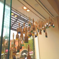 window display/art installation at Kate Spade store... dipped paint brushes
