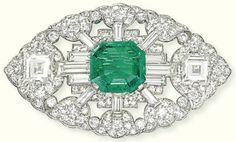 AN ART DECO EMERALD AND DIAMOND BROOCH, BY BULGARI Of navette outline, the rectangular-shaped emerald centre to the openwork baguette and circular-cut diamond palmette surround with square-shaped diamond shoulder detail, circa 1935, 5.3 cm wide Signed S. Bvlgari