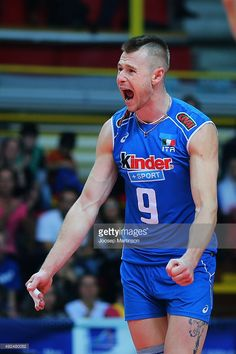 Ivan Zaytsev #9 of Italy celebrates winning a point during CEV Volleyball European Championship play-off match between Italy and Finland at Pala Yamamay Arena on October 13, 2015 in Busto Arsizio, Italy.