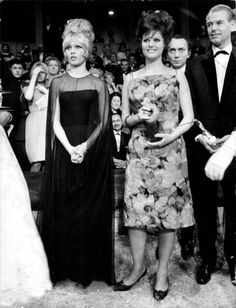 Brigitte Bardot and Claudia Cardinale at an awards gala in Brussels, 1961.