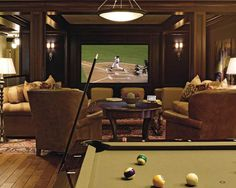 """a nice """"man-cave"""" ... pool table, bar, big screen TV, and lots of comfy seating!"""