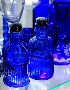 Two of my cobalt glass pieces in my collection, these two salt shakers have quite the character. You can see them in context with other collection pieces in the previous image. Old Bottles, Antique Bottles, Antique Glass, Glass Bottles, Vintage Bottles, Vintage Perfume, Perfume Bottles, Im Blue, Blue And White