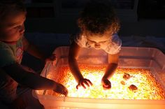 Water beads over a light table -- what a cool sensory activity! Water Beads - the post that started a CRAZE!! | Activities For Children | Water Beads | Play At Home Mom