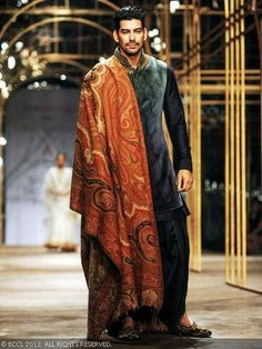 Sunil Singh walks the ramp for designer Tarun Tahiliani during India Bridal Fashion Week '13, held at Grand Hyatt, in Mumbai, on November 29, 2013.