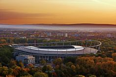 Hannover, Germany - football arena in the center, the Deister hills in the background