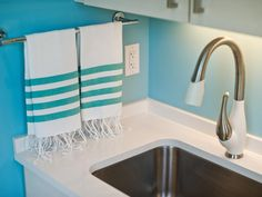 A bright and cheery wall color and state-of-the-art appliances shine in an otherwise quiet HGTV Dream Home space.