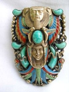 i want to live inside the world of art deco egyptian revival...