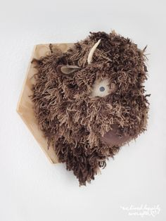 DIY Buffalo head stuffed animal taxidermy tutorial.  This is a bit involved, but super cute and absolutely one of a kind.  The site gives full instructions and a pattern!