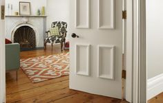 Apply panel molding to a featureless door to create a grand entrance to any room