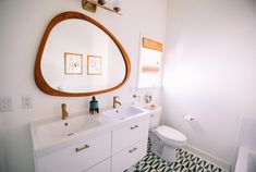 Double Vanity Bathroom Mirrors: Ideas and Inspiration | Hunker Minimalist Bathroom Design, Double Vanity Bathroom, Bathroom Trends, Vintage Bathrooms, Amazing Bathrooms, Round Mirror Bathroom, Modern Bathroom Vanity, Bathroom Renovations, Bathroom Design Trends