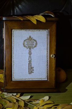 Wooden key box with the handmade cross stitched key by BestByKoval